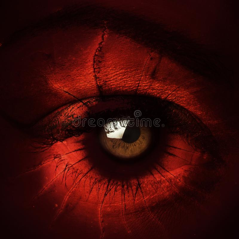 Closeup of terrify demon eye composite photo stock images