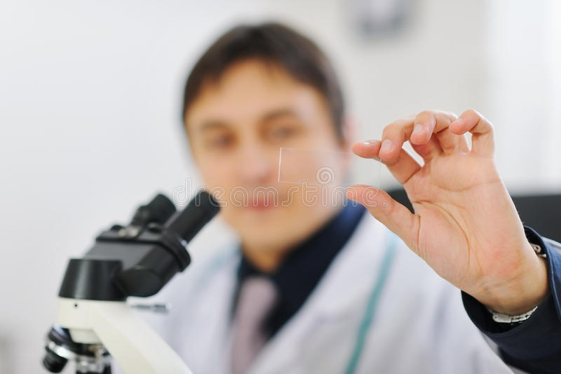 Closeup on test sample in hand of male researcher royalty free stock photos