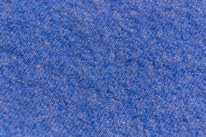 The closeup texture of blue cashmere sweater background. Macro shot of knitted fabric from wool threads. Lana, surface, organic, white, pattern, soft, material royalty free stock photos