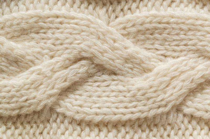 The closeup texture of cashmere things. Macro shot of knitted fabric from Lana Wool threads. Warm winter clothes. Background textile surface with copy space royalty free stock image