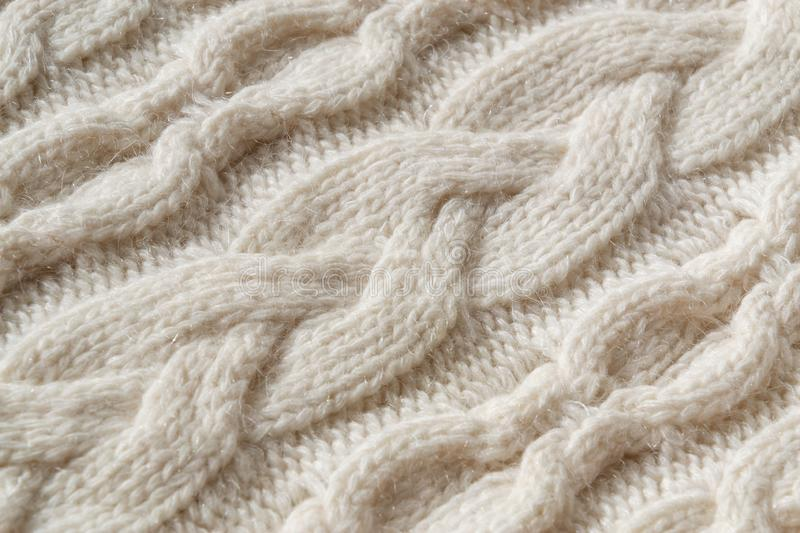 The closeup texture of cashmere things. Macro shot of knitted fabric from Lana Wool threads. Warm winter clothes. Background textile surface with copy space royalty free stock photo