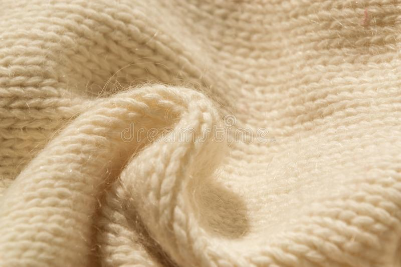 The closeup texture of cashmere things. Macro shot of knitted fabric from Lana Wool threads. Warm winter clothes. Background textile surface with copy space royalty free stock photography
