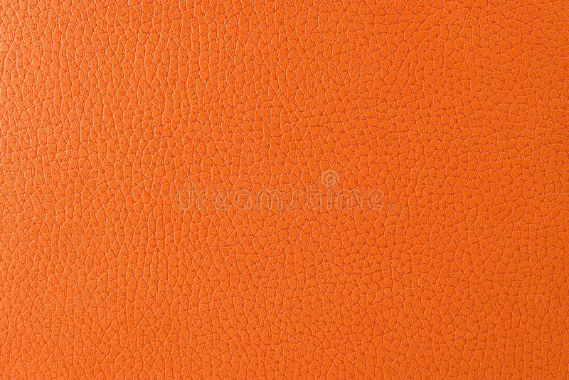 Closeup texture of orange imitation leather royalty free stock images