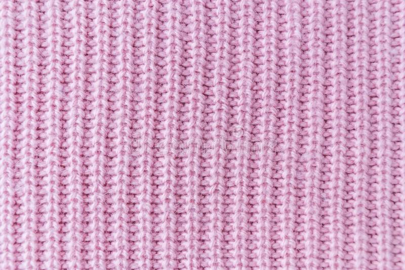 The closeup texture of pink cashmere sweater background. Macro shot of knitted fabric from Lana Wool threads. Surface, organic, white, pattern, soft, material royalty free stock photography
