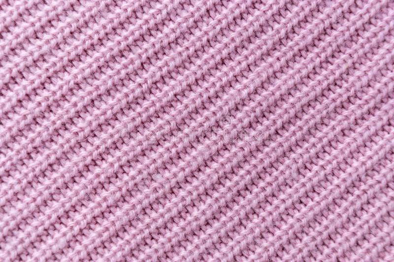 The closeup texture of pink cashmere sweater background. Macro shot of knitted fabric from Lana Wool threads. Surface, organic, white, pattern, soft, material stock photography