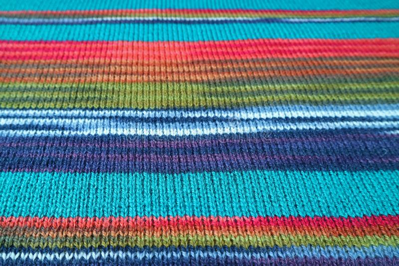Closeup the Texture of Turquoise Blue with Colorful Striped Alpaca Knitted Wool Fabric for Background royalty free stock photos