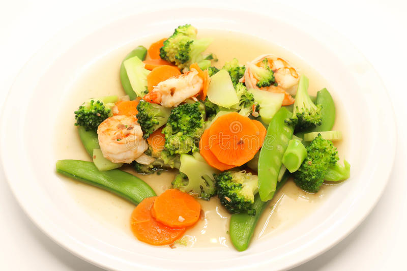 Closeup Thai food stir fried broccoli with shrimp on white plate royalty free stock photography