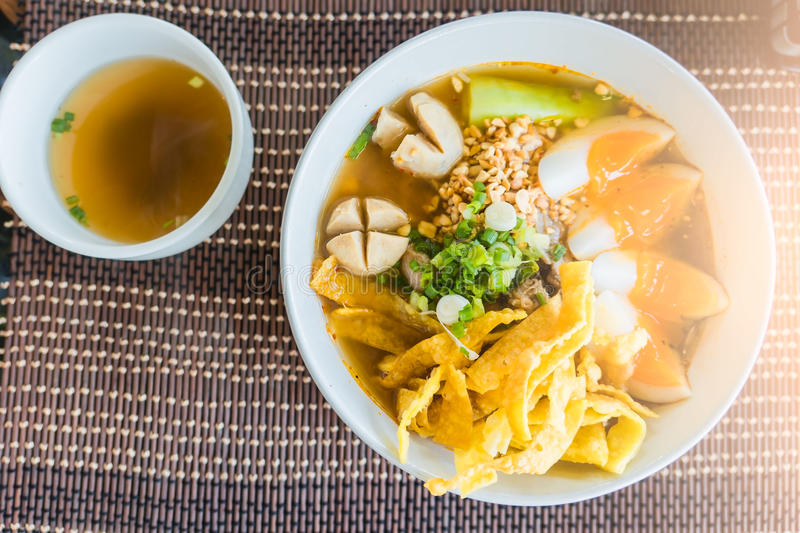 Closeup Thai noodles with boiled in a bowl. At restaurant.  royalty free stock images