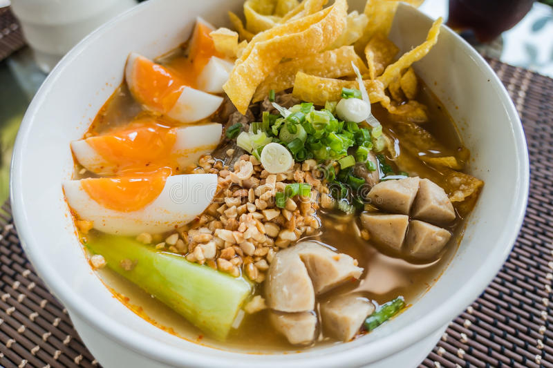 Closeup Thai noodles with boiled in a bowl. At restaurant.  stock photos