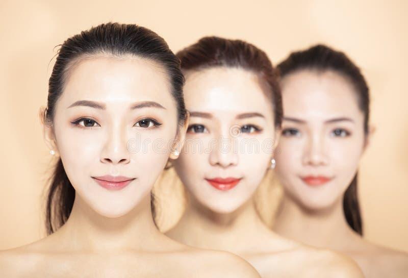 Closeup of three asian beauty face royalty free stock photography