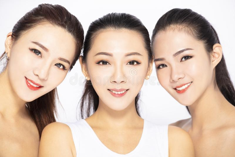 Closeup of three asian beauty face stock images