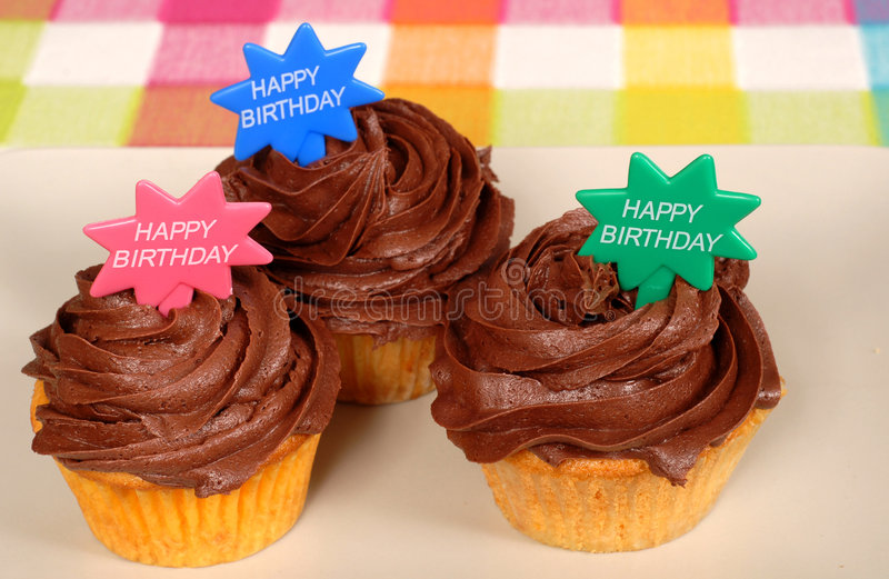 Download Closeup Of Three Chocolate Frosted Cupcakes With Stock Image - Image: 1773243