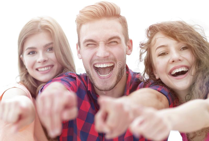 Closeup of three happy young people showing hands forward stock image