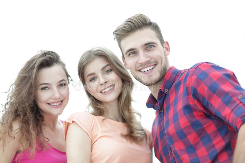 Closeup of three young people smiling on white background royalty free stock image