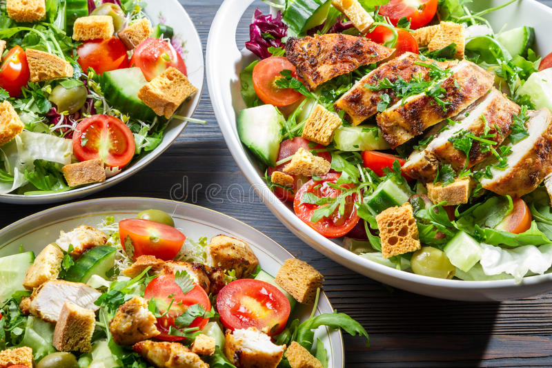 Closeup of three healthy salads with vegetables stock photography