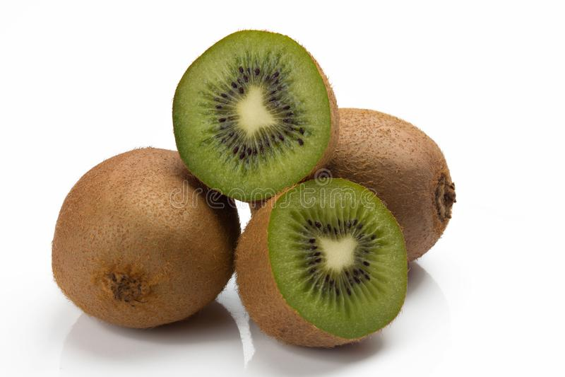 Closeup of three kiwis, two whole and one cut royalty free stock photography