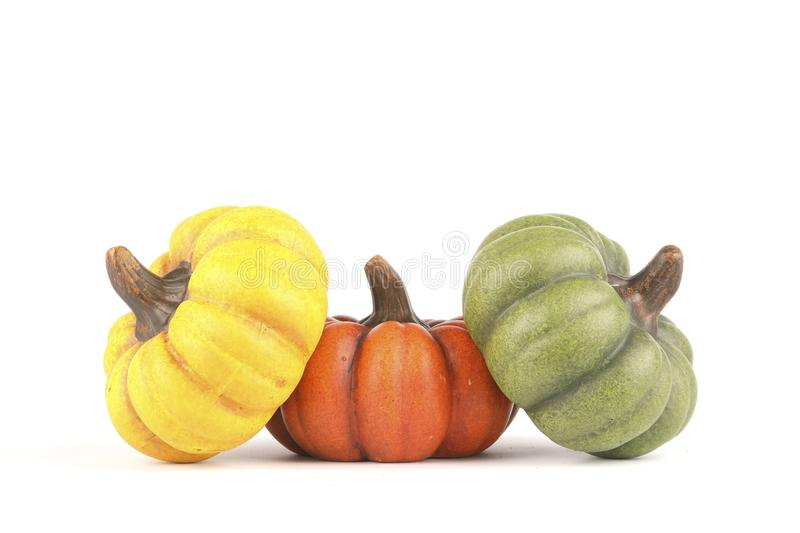 Three pumpkins made of clay royalty free stock photography