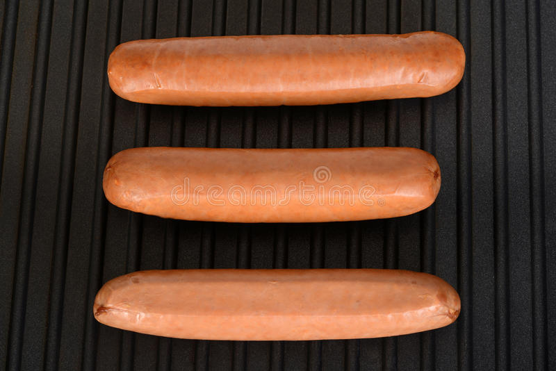 Closeup three smoked sausages royalty free stock photography