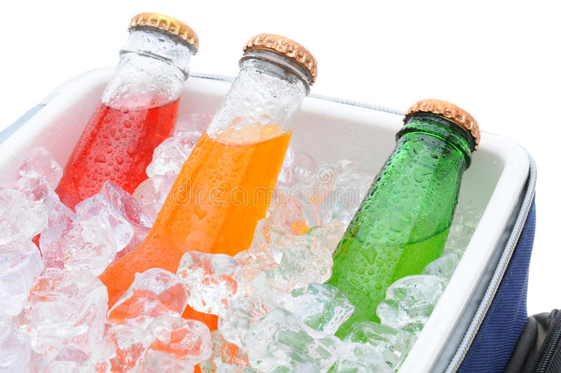 Closeup of three soda bottles in ice chest. Closeup of three different soda bottles in a small cooler full of ice cubes royalty free stock photo