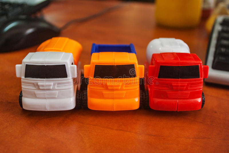 Closeup of three vans on the desk in the office mouse and keyboard defocuses. Closeup of three vans on the working desk in the office mouse and keyboard stock photography