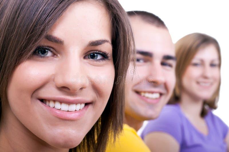 Closeup of three young people stock photos