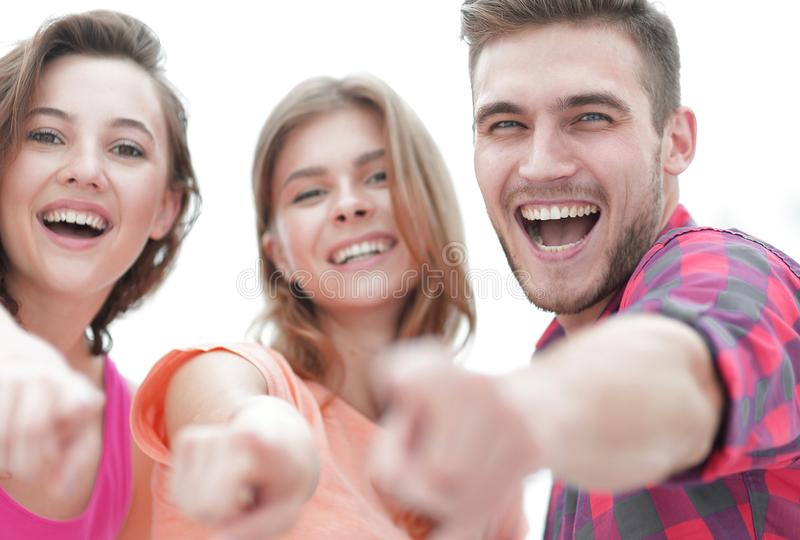 Closeup of three young people showing hands forward royalty free stock images