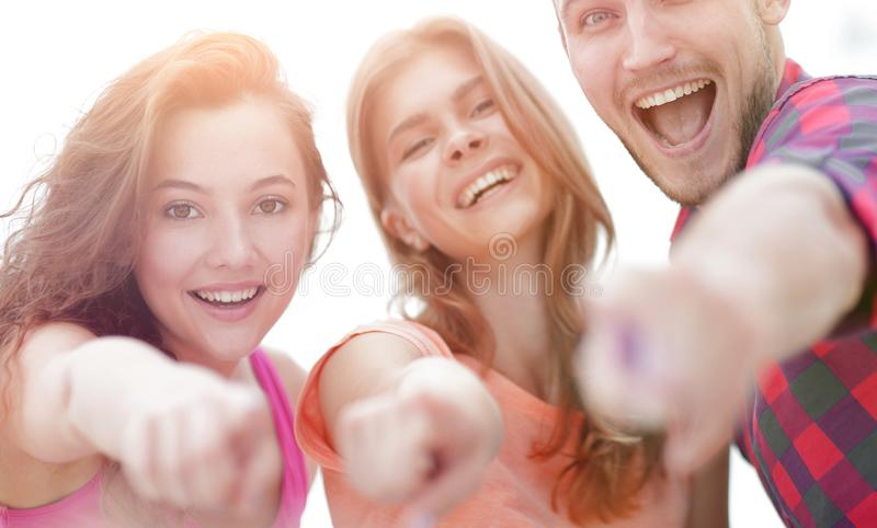 Closeup of three young people showing hands forward stock photos