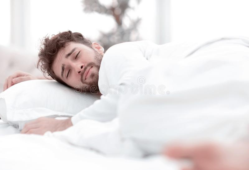 Closeup.the tired men sleep soundly on the bed. Closeup.the tired man sleep soundly on the bed .photo with copy space royalty free stock photo