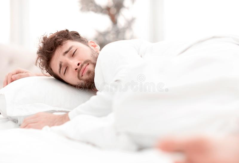 Closeup.the tired men sleep soundly on the bed stock photography