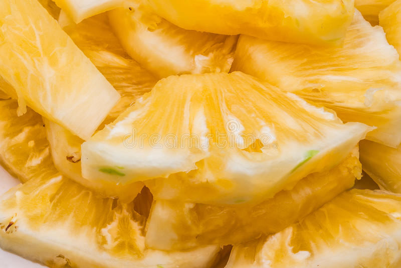 Closeup to Fresh Ripe Sliced Pineapple Background royalty free stock photography