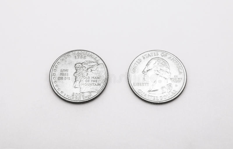 Closeup to New Hampshire State Symbol on Quarter Dollar Coin on White Background.  royalty free stock photos