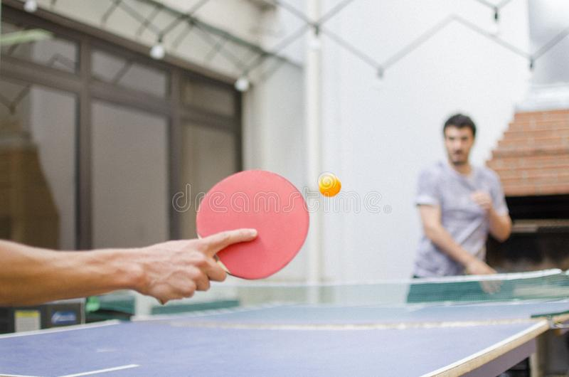 Closeup to a sportsman`s hand playing table tennis stock images