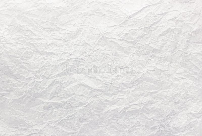 Closeup to white crumpled paper texture background,abstract. Copy space