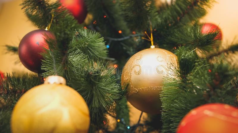 Closeup toned image of red and golden sparkling ball hanging on Chrismtas tree. Perfect abstract background for winter royalty free stock photos