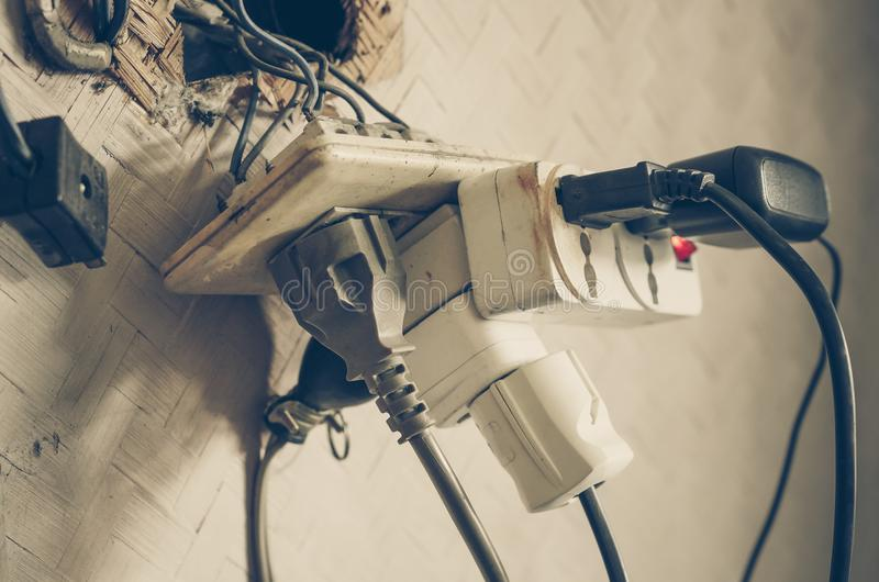 Too many plugs in a socket stock image