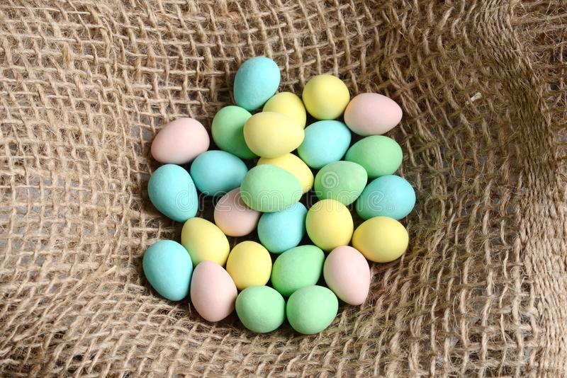 Closeup top view easter candy eggs in a nest stock image