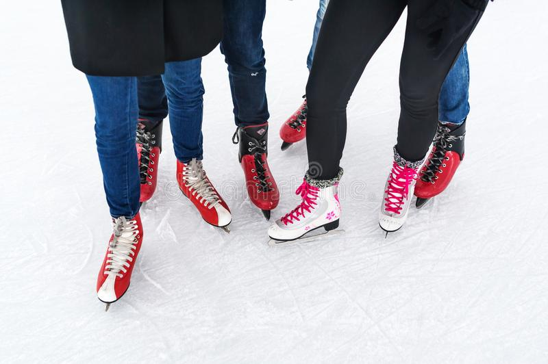 Closeup top view of legs in modern skates on ice rink. royalty free stock photography