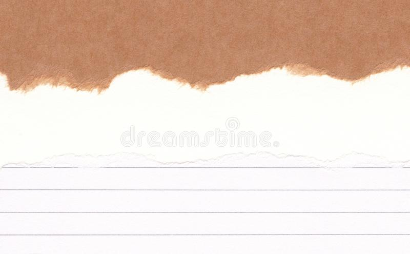Closeup torn brown paper on grunge torn lined ,white paper texture background.Rip Paper note ,brown sheet with space for text ,pat. Tern or abstract artwork stock photography