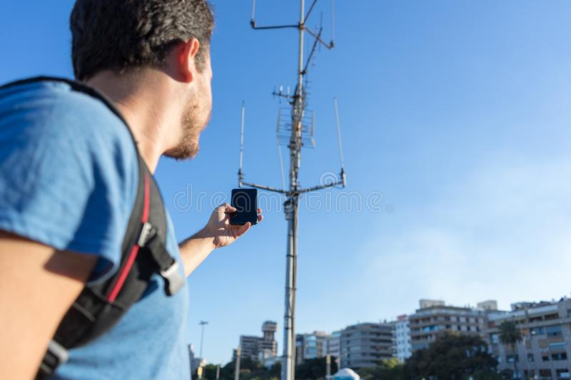 closeup Tourist With No Cellphone data Or Network. Man holding mobile telephone and searching for signal internet connection. royalty free stock image