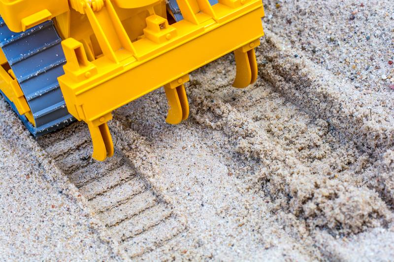 Grain pulls furrows in the sandbox stock images