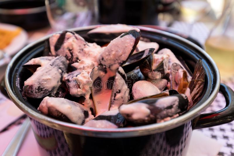 Closeup of traditional dish of French cuisine, appetizing  mussels with sauce in Pyla-sur-Mer. stock images