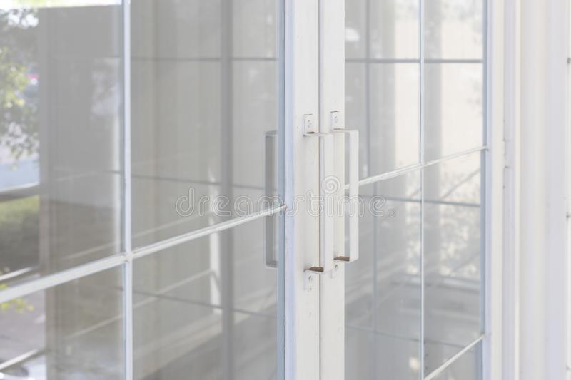 Closeup of transparent glass with white steel door handle royalty free stock photos