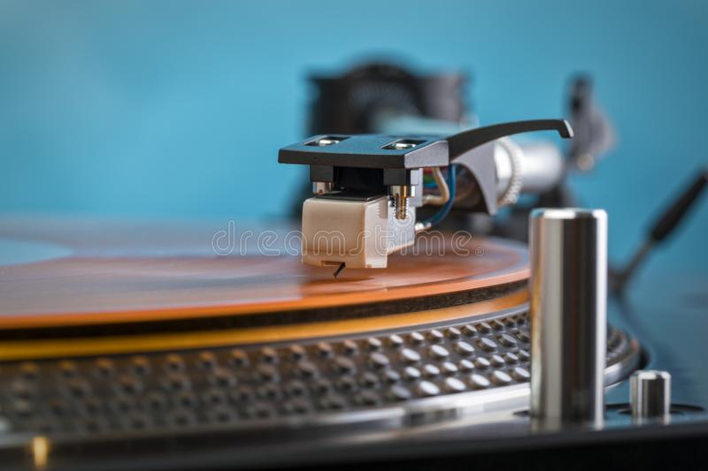Turntable needle on colored vinyl record stock photography