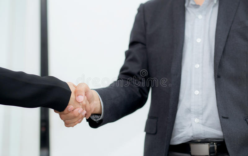 Closeup of two business people shaking hands - Handshake royalty free stock photos