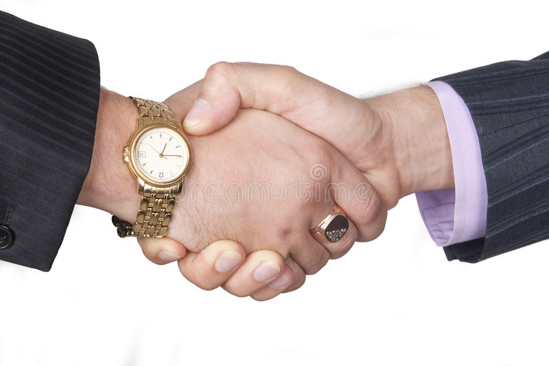 Closeup of two businessmen shaking hands on white stock photos