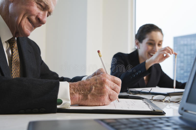 Closeup of two executives in conference meeting. View of businesspeople working in an office stock photo