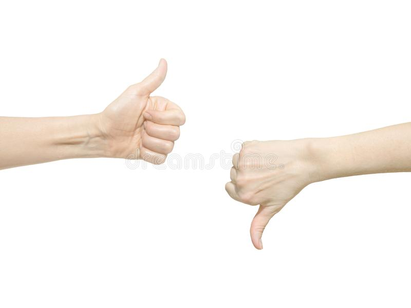 Closeup of two female hands showing thumb up and down signs against white background. Isolared communication gesture objects to sh royalty free stock images