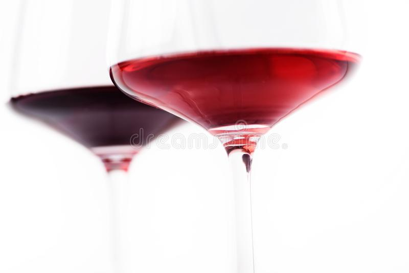 Closeup of two glass of red and rose wine  over white background royalty free stock photos
