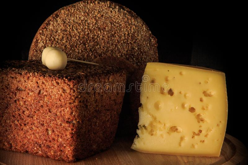 closeup two handmade rye bread and hard cheese piece stock photos