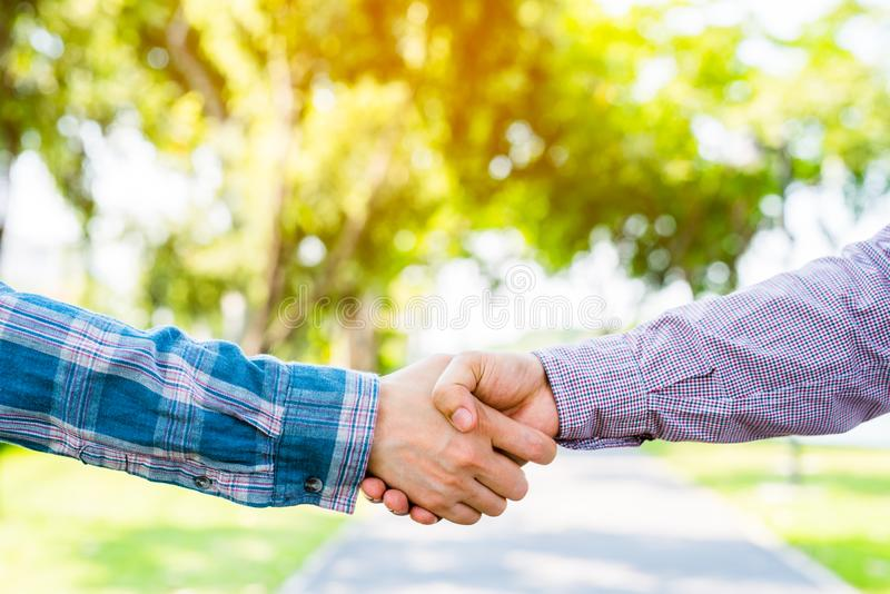 Closeup of people shaking hands stock photo